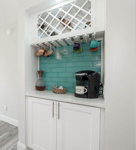 White Shaker Cabinets and wine rack